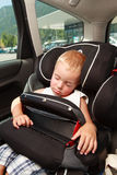 Boy and car seat safety. Stock Photo