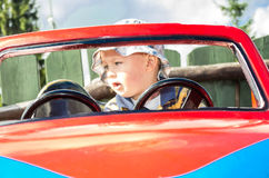 Boy in the car Stock Image