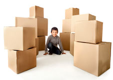 Boy with cardboard boxes Royalty Free Stock Photography