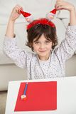 Boy With Cardpaper And Pencil Holding Santa Royalty Free Stock Photos