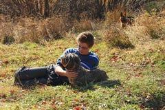 Boy caress dachshund dog stock photography