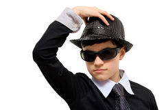 Boy with carnival costume. Man in black. Teenager in carnival costume, wearing hat and black sunglasses as a detective. Image isolated on white Royalty Free Stock Photos