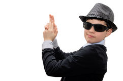 Boy with carnival costume. Man in black. Teenager in a carnival costume, wearing hat and sunglasses. Pretending to have an imaginary gun in his hands. Image Stock Photography