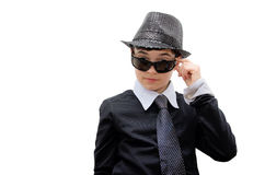 Boy with carnival costume. Teenager in a black carnival costume, wearing hat and sunglasses as a detective. Image isolated on white Royalty Free Stock Images