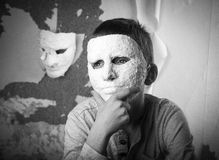 Boy with carnival mask. Black and white photo Stock Image