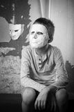 Boy with carnival mask. Black and white photo Royalty Free Stock Photos