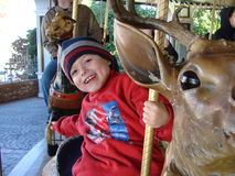 Boy on Carousel Royalty Free Stock Images