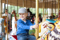 Boy at carousel Stock Photos