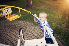 Boy on carousel Royalty Free Stock Photos