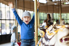 Boy at carousel Stock Images