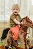 Boy on the carousel Stock Images