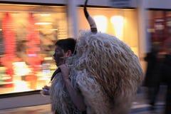 The boy carries bull head. Rijeka Carnival. it is the biggest carnival in Croatia. 2013 royalty free stock image