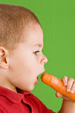 Boy and carrot Royalty Free Stock Image