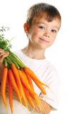 Boy with carrots Stock Photography