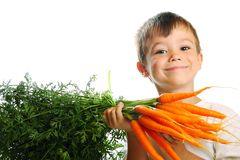 Boy with carrots Stock Photo