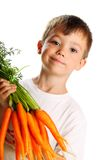 Boy with carrots Royalty Free Stock Image