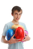 Boy carrying 4 large easter eggs Stock Photography