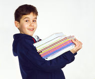 Boy carrying books Stock Photography