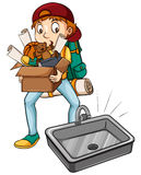 A boy carrying a box Stock Images