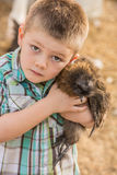 Boy Carrying Chicken Royalty Free Stock Image