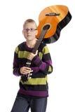 Boy carrying a guitar Stock Photos
