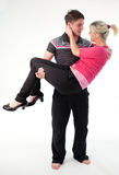 Boy carrying his girlfriend in his arms. Attractive boy carrying his girlfriend in his arms royalty free stock photos