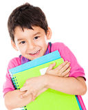 Boy carrying notebooks Stock Image