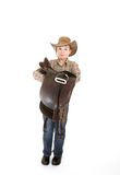 Boy carrying a saddle Stock Photos
