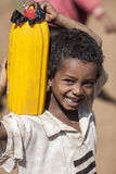 Boy carrying water, Ethiopia Stock Images