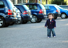 Boy by cars. Stock Photo