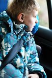 Boy in carseat. Looking in the window Stock Image
