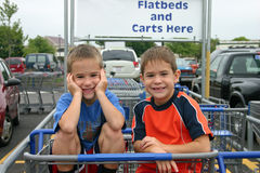 Boy in Cart. Boys in parking lot of store Stock Photography