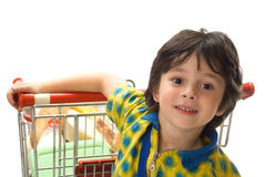The boy with cart for shoop royalty free stock image