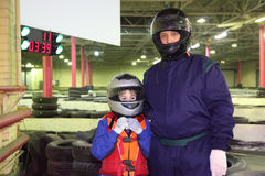 Boy and carting trainer are standing in helmets Stock Image