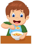 Boy cartoon is having cereal for breakfast Stock Image