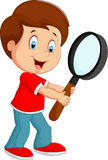 Boy cartoon holding a magnifier Stock Photo