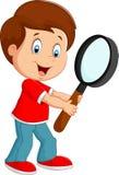 Boy cartoon holding a magnifier Stock Photo