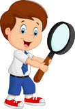 Boy cartoon holding a magnifier Stock Photography