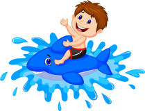 Boy cartoon playing with swimming toy Royalty Free Stock Photography