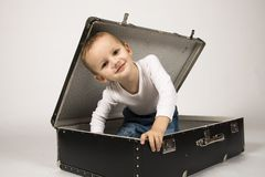Boy and case. Portrait of a cute boy in a case Royalty Free Stock Photo