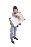 Boy with case in hands. Teenage boy embraces a metallic attache case standing isolated on white background stock images