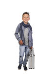 Boy with case. Happy teenage boy with metallic attache case in hand stands isolated on white background royalty free stock images