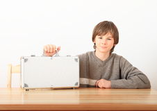 Boy with case for money Stock Image