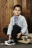 Boy on case, thinking Royalty Free Stock Photography