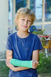 Boy with cast Stock Photography