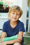 Boy with cast on right hand Royalty Free Stock Image