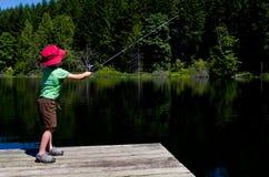 Boy casting fishing line stock photos