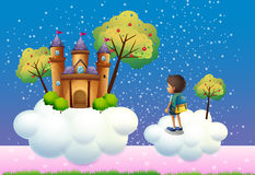 A boy and a castle above the clouds Royalty Free Stock Photos