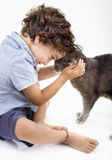 Boy and cat. Young boy playing with a gray cat Royalty Free Stock Photos