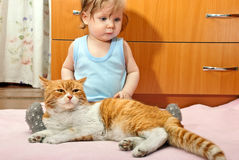 Boy and cat stock photo
